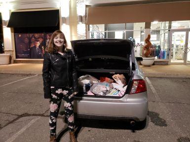 Marissa at car